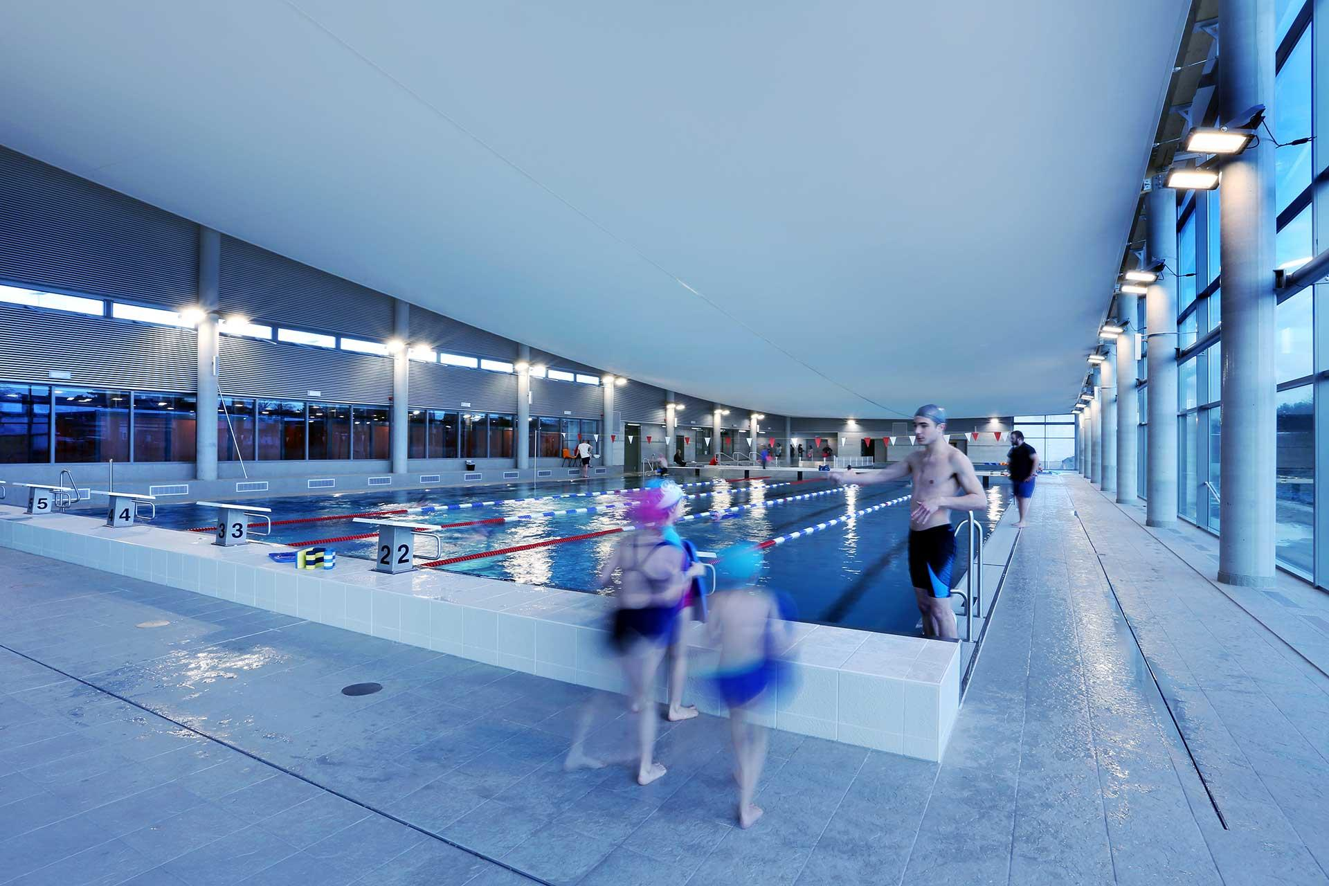 Schréder sports lighting solution cuts energy costs by 67% for Ans swimming pool